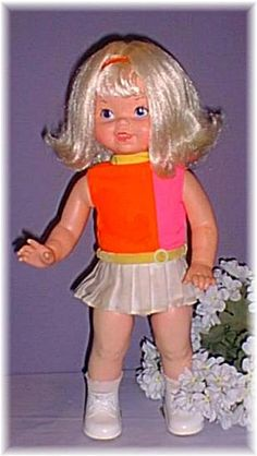 Swingy. I know, she's scary. I still have her, although she no longer swings and her head is detached.