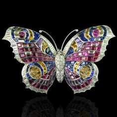 Art Deco multi-gem brooch designed as a Peacock butterfly in ruby, diamond, amethyst and blue and yellow sapphires with a diamond-set body and further diamond highlights. Circa 1935 Photo courtesy Hancocks & Co…. Insect Jewelry, Butterfly Jewelry, Butterfly Art, Animal Jewelry, Butterflies, Bijoux Art Deco, Art Deco Jewelry, Fine Jewelry, Jewelry Design