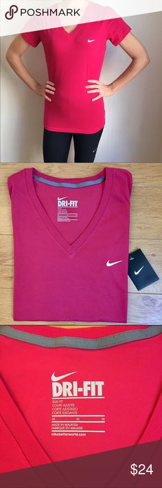 Nike Pink Dri-Fit V-Neck Slim Fit Tee BRAND NEW Nike women's slim-fit V-neck short sleeve athletic tee. Pink with white Nike swoosh logo on the chest. Moisture wicking dri-fit fabric is 60% cotton/40% polyester. Flattering slim fit hugs your curves. Nike Tops Tees - Short Sleeve