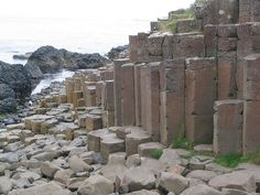 The Giant's Causeway in northeast coast of Northern Ireland, is an area of about 40,000 interlocking basalt columns, the result of an ancient volcanic eruption. The tops of the columns form stepping stones that lead from the cliff foot and disappear under the sea. Most of the columns are hexagonal, although there are also some with four, five, seven and eight sides.