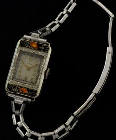 Beyond stunning - 1928 Elgin Lady and Tiger watch, styled by Lucien Lelong.