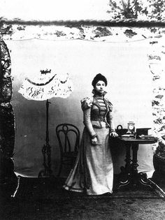 """Portrait of his fiancée. Ali Sami, Istanbul, c.1880 (Sarah Graham Brown - Images of Women)  """"Ottoman photographer Ali Sami took this portait of his fiancée in a garden, possibly for reasons of lighting. It is interesting to see the objects included in the set: a lamp, a clock, a carpet, and some small household items that subtly indicate aspects of late-nineteenth century bourgeois life. She holds a small paintbrush, a reference to the fact that she was a painter."""""""