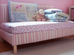 DIY Upholstered Toddler Daybed Reading spot by day, comfortable padded bed by night. Repurpose a standard crib mattress and bedding to create your own upholstered toddler daybed with simple tools and no sewing.
