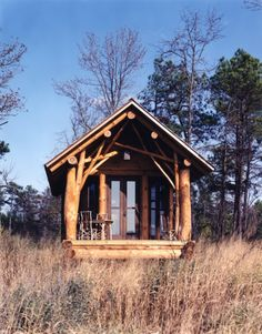 rustic cabin with treetrunk porch columns | Centerbrook Architects | photoby Norman McGrath