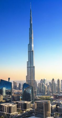 Burj Khalifa! Not only is the Burj Khalifa the tallest building in the world, but it is almost 1,000 feet taller than its closest competition.   To get up and down, it also houses the fastest elevator in the world.  Click to read the top 10 things to do in Dubai!