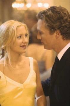 How To Lose A Guy In 10 Days, 2003Costume design: Karen Patch30's-style bias cut gold satin dress with cross-back detail worn by Kate Hudson in the role of Andie Anderson