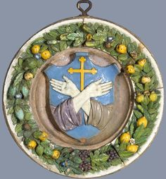 Luca della Robbia, Coat of Arms of the Franciscan Order, c. 1525, glazed terracotta, diameter: 75.6 cm (29 3/4 in.), depth: 11.4 cm (4 1/2 in.), North Carolina Museum of Art, Raleigh, Purchased with funds from the North Carolina State Art Society (Robert F. Phifer Bequest).