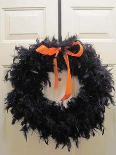 easy halloween wreath using feather boa and ribbon