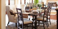 I like the idea of the high back love seat as seating on one side of the formal dining.
