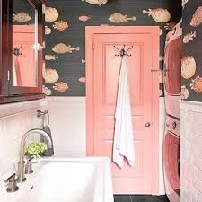 I'm in love with this idea for a bathroom design. The pink door is divine and check out the fish wallpaper from Cole and Son