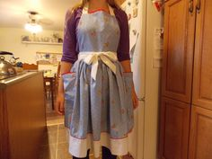 Hand sewn apron with white and red border made from vintage cotton sheet by content 2B sew. Sold at Scattered Seeds Winnipeg October 2014.