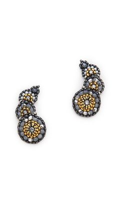 Unique Miguel Ases earrings in a tapered shape that crawls up the ear. 18k gold-plated bead, hematite stone, and Swarovski crystal accents. 14k gold-fill post closure.  Made in the USA.  Measurements Length: 1.25in / 3cm $150.00