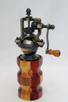 "This peppermill has an antique-style peppermill mechanism that adjusts easily from coarse to extra fine. The metal is an Antique Brass finish. It does not accommodate salt since it is metal. The body of the mill contains 42 pieces of exotic woods. It is approx. 2.5""dia. x 8""H. Cards for the Care of Wood and the names of all the woods and origin are sent with the purchase. # 618  0802"