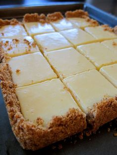 CREAMY LEMON SQUARES: FOR THE CRUST 4 tablespoons butter, melted and cooled, plus more for pan cup graham cracker crumbs ¼ cup sugar FOR THE FILLING 2 large egg yolks 1 can ounces) sweetened condensed milk ½ cup fresh lemon juice lemons) How 13 Desserts, Lemon Desserts, Lemon Recipes, Recipes For Lemons, Lemon Cakes, Party Desserts, Low Carb Dessert, Dessert Bars, Paleo Dessert