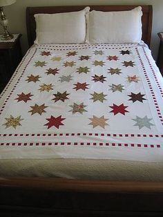 "The pattern is Coventry, from the book Comfort & Joy by Brenda Riddle. I used one layer cake of the fabric group ""Peace On Earth"" by 3 Sisters for Moda. The background is Kona White and the red in the checkerboard borders is a Moda Marbles"