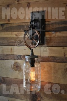 The Warehouser Custom Pulley Pendant Chandelier by MoonshineLamp. Great wall sconce with Edison bulb and mason jar. Farmhouse Lighting, Rustic Lighting, Unique Lighting, Industrial Lighting, Rustic Farmhouse, Kitchen Rustic, Bar Lighting, Kitchen Lighting, Rustic Wood
