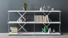 They might look good stacked on top of each other (with careful, discreet joining)  http://hem.com/en/product/lift-3-shelf-10042/
