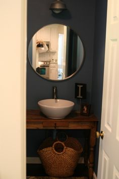 Half Bath - love the round mirror and the sink