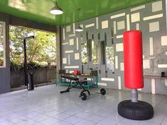 Hang that 🥊 trainer and start to rumble #gym #fitness #room  #eco #recycle #barbell #shleves #wall #decor #mirror #reflection #interior #exterior #renovation #project #healthy #fit #lifestyle #school #student #boxing #fight #circuit #training #green #tree #natural #view #mondayfunday #sekolahmutiarabunda Reposted Via @nick_mutiarabunda