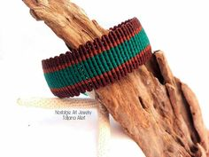Macrame handmade bracelet. Unisex !! Tangled with best quality waxed threat in Braun , beige and turquoise color. Every item comes wrapped in a beautiful gift box with a ribbon, and ships through ELTA with a tracking number. To see more Macrame Jewerly from my collection, you can go to