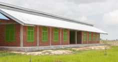 Building Trust International partnered with Weston Williamson + Partners to design and build a new rural school for a rural community in Cambodia. The building combines the school's needs with elements of traditional local architecture for maximum sustainability.