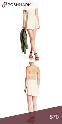 NWT FREE PEOPLE More Than A Mini Lace-Up Dress - Ruffle trimmed scoop neck - Sleeveless - Lace-up crisscross back - Button loop back closure - Slips on over head - Imported - 100% cotton - NWT, never worn! Free People Dresses Mini