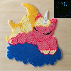 Unicorn sleeping on the clouds glowing perler beads by Szilvi