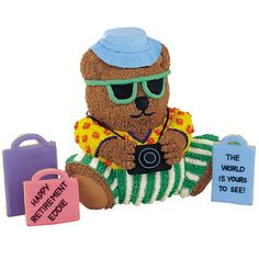 Say, ?So long? to world travelers in a memorable way. Thanks to clever alterations and artistically applied icing, a Stand-Up Cuddly Bear Pan cake converts to sightseer and cookies turn into tourist trappings.