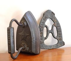 Antique Sad Iron & Matching Trivet. Made by the W. H. Howell Co. (Geneva, Illinois) c. late 1800s - early 1900s.   via CassiesTaleVintage on Etsy.