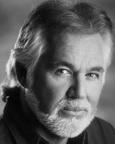 Any thing by Kenny Rogers--this was before the terrible plastic surgery..  He was handsome.