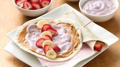 Wrap sliced fruit and yogurt and peanut butter in flour tortillas. Mikey says it looks good, we will try this