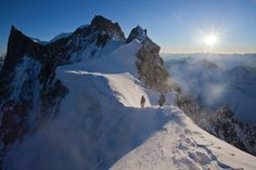 Rochefort arete in winter. In the far distance lies the Grandes Jorasses. Mont Blanc massif, France
