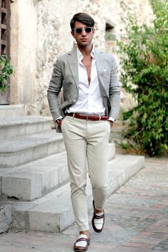 Pair a grey blazer with beige chinos for a work-approved look. Finish off this look with white and brown leather loafers.   Shop this look on Lookastic: https://lookastic.com/men/looks/blazer-dress-shirt-chinos-loafers-pocket-square-belt-sunglasses-watch/12205   — Grey Sunglasses  — White Dress Shirt  — White Pocket Square  — Grey Blazer  — Black Leather Watch  — Burgundy Leather Belt  — Beige Chinos  — White and Brown Leather Loafers