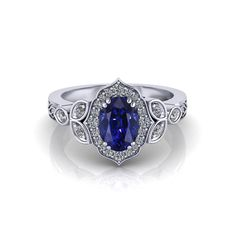 This Chevron Halo Sapphire Ring is a beautiful is breathtaking. Crafted with a stunning diamond framework and etched shank, this oval halo ring showcases a vibrant carat blue sapphire at its center. Oval Halo Ring, Halo Rings, Bali Jewelry, Jewelry Rings, Jewelry Ideas, Black Diamond Bands, Sapphire Jewelry, Eternity Bands, Blue Sapphire