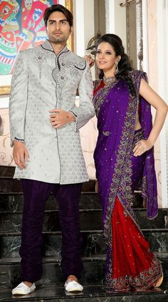 Flamboyant white and purple brocade readymade sherwani which is crafted with butta, lace, moti, patch, resham and stone work all over. Stole and mojari can be purchased additionally. They are not a part of this sherwani.