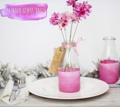 super-quick DIY was born, using leftover paint samples to decorate glasses and vases to fill with garden blo