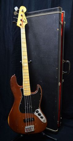 Fender 1973 Jazz Bass Mocha Brown Electric Guitar Mocha Brown Finish Maple Neck and Fingerboard with White Pearl Block Inlays Style Headstock Light Weight Alder Body Wood Fender Bass Guitar, Fender Guitars, Custom Electric Guitars, Custom Guitars, Bass Guitars For Sale, 70's Style, Mocha Brown, Vintage Guitars, Guitars