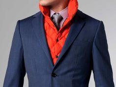 The combination of orange vest with a blue suit, truly unique.
