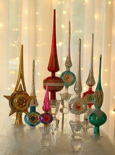 vintage christmas tree toppers in candleholders