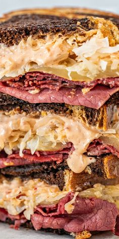The BEST recipe for a homemade Reuben Sandwich. Slices of corned beef with sauerkraut, swiss cheese, and our homemade Russian dressing between slices of rye bread. Entree Recipes, Sandwich Recipes, Russian Dressing, Reuben Sandwich, Rye Bread, Delicious Sandwiches, Swiss Cheese, Corned Beef, Sauerkraut