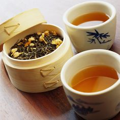 Teacups and Dried Tea Leaves in Bamboo Container