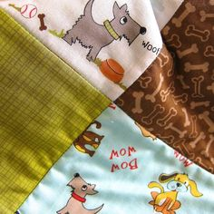 The Dog's Quilt features Puppy Park fabrics from Riley Blake Designs