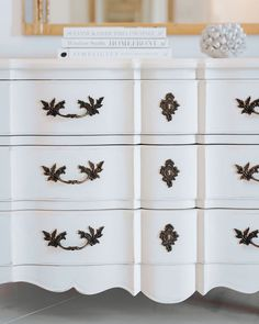 Close-up of the soft curves and hand carvings that give the Genevieve Dresser from AVE Raw its beguiling depth and character. The piece comes unfinished but is pictured here painted a soft white. | Ave Home