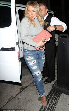 Jean-ius style: Hilary kept it casual but chic in a tight grey turtleneck and ripped jeans...