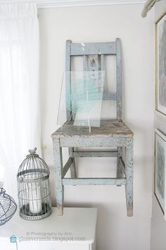 Hang an antique chair on the wall. Old things - new use! The contrast between old and new add magic to a room! ;)) Styling and photography by Ann, Glassveranda. (glassveranda.blogspot.com)