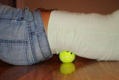 Tennis Ball as Massager..   Tip: Put the ball in a long sock or stocking, throw it over your shoulder and you can move it around without dropping while rolling against a wall.