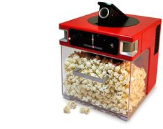 "The Popinator Project by http://www.popcornindiana.com aims to change the popcorn eating experience by making it more fun. The idea behind The Popinator is to instantly deliver popcorn into a person's mouth just by saying the word ""pop"". The Popinator is able to pinpoint where in the room the spoken word originated from and shoot a piece of popcorn at it. The Popinator shoots up to 15 feet and is for inside use only."