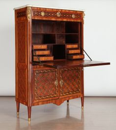 A Fine French Ormolu-Mounted, Kingwood, Tulipwood & Stained Sycamore Marqueterie & Parquetry Secretaire Abattant With Rectangular Molded White Marble Top , Above A Frieze Drawer Inlaid With Flower Heads , Fall Front Enclosing A Leather-Lined Writing Surface & Six Small Drawers and Pigeon-Holes , Above a Pair of Cupboard Doors,  Louis XVI,  Stamped Stockel, Joseph Stockel recu maitre en 1775.