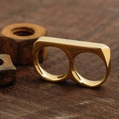 Love this stylish gold double-finger ring from Vitaly