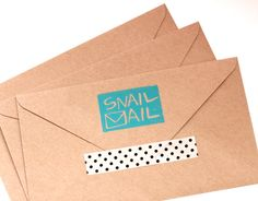 Jazz up your snail mail with a DIY stamp, washi tape, and kraft envelopes.